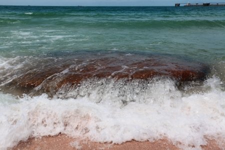 wave hitting on rock Stock Photo