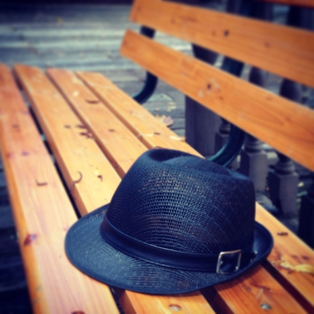 Black hat on chair use for wallpaper
