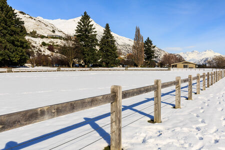 sunny winter clear sky and wooden fence photo