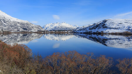 mirror on the water: mirror water surface at Lake Hayes, Queenstown, New Zealand