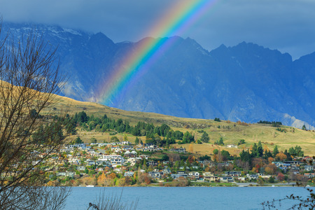 nant: Bright rainbow after rain above Kelvin Height area, Queenstown, New Zealand Stock Photo