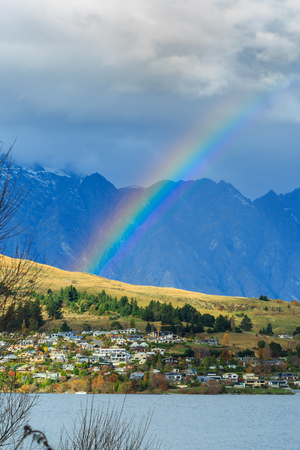 kelvin: Bright rainbow after rain above Kelvin Height area, Queenstown, New Zealand Stock Photo