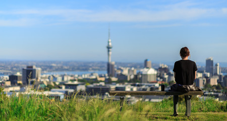 Woman enjoys spectacular morning views of Auckland city Stok Fotoğraf - 41859218