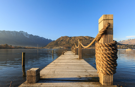 Wooden pier in the morning at Lake Wakatipu, Queenstown, New Zealand Stock fotó