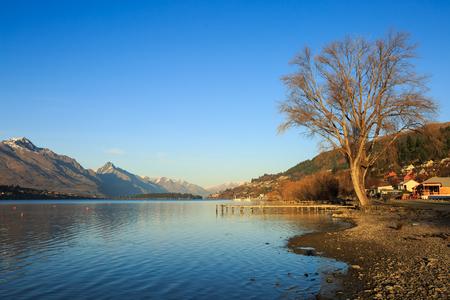 wakatipu: Wooden pier in the morning at Lake Wakatipu, Queenstown, New Zealand Stock Photo