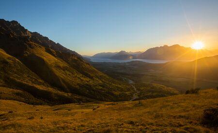 faintly visible: Golden Sunset. Queenstown New Zealand