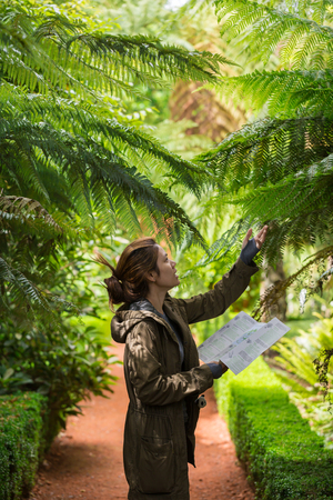 new job: Young woman examine Silver Fern. New Zealand