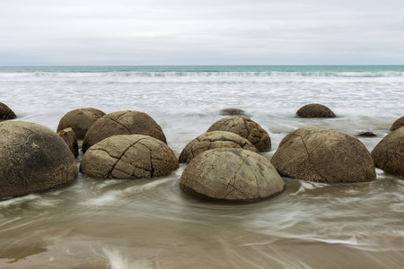 south island new zealand: Long exposure image of Moeraki Boulders, South Island New Zealand