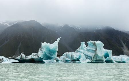 new zealand: floating icebergs in Tasman Glacier Lake. AorakiMount Cook National Park New Zealand Stock Photo