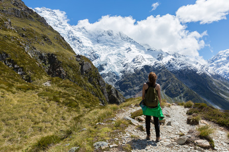 aoraki mount cook national park: Woman Traveler with Backpack hiking in Mueller Hut Route, Mount Cook National Park, New Zealand