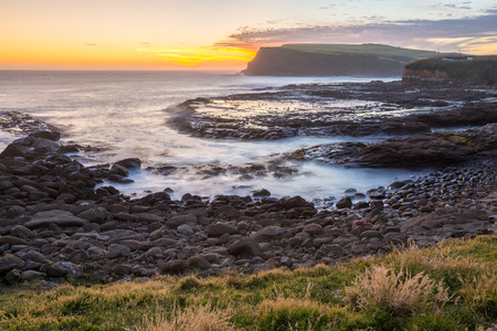 curio: Golden sunset at Curio Bay, the Catlins, New Zealand