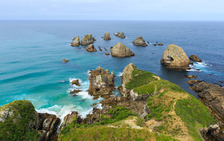 landforms: Nugget Point is one of the most iconic landforms on the Otago coast, surrounded by rocky islets The Nuggets. it is home to many seabirds, including penguins, gannets and spoonbills, Stock Photo