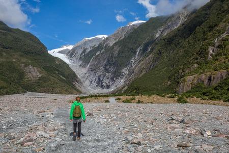 fox glacier: Woman Backpacker walking in Franz Josef Glacier, New Zealand