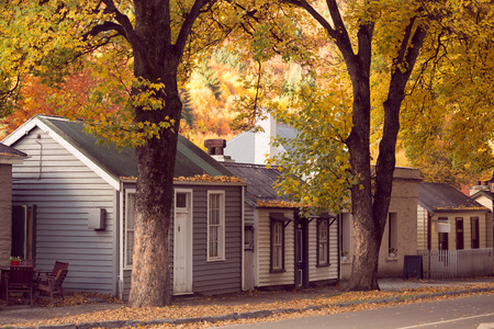 houses street: Vintage style image of Autumn in Arrowtown. Arrowtown is a historic gold mining town in the Otago region of the South Island of New Zealand.