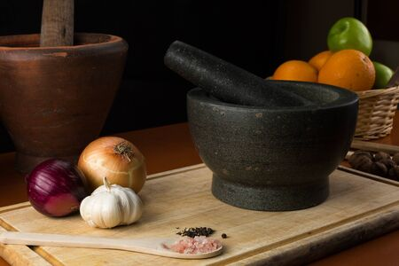 thai arts: Fine art still life with mortar and pestle on Cutting Board