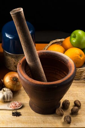 fine art: Fine art still life with mortar and pestle on Cutting Board
