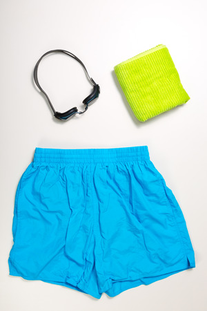 swimming suit: top view of collection of Swimming suit, caps and glasses