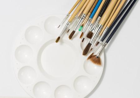 art palette: art palette with brushes Stock Photo