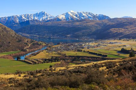 urban scene: aerial view of Frankton and Lake Wakatipu from the Remarkables Mountain,  Queenstown, New Zealand