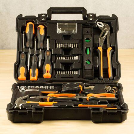 chrome vanadium: Black toolbox on wood table Stock Photo