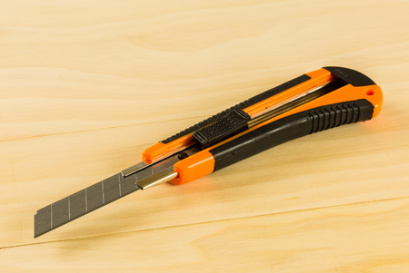 wood cutter: orange cutter on wood table