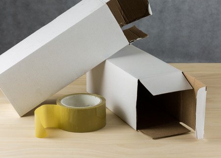 packing tape: Close up Packing Tape and white boxes on white table