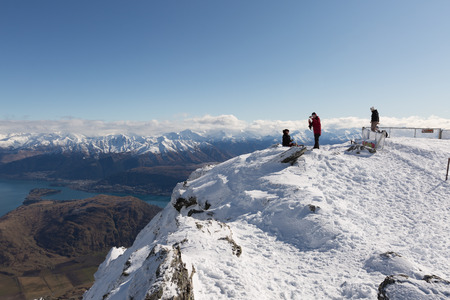 Ski Area: QUEENSTOWN, NEW ZEALAND - AUGUST 6: Unidentified skiers and snowboarders enjoy the view of Queenstown from  top of The Remarkables Ski Area on August 6, 2015 in Queenstown, South Island, New Zealand Editorial