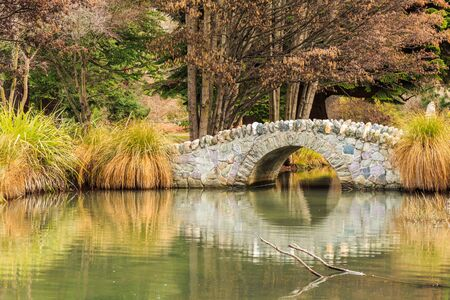 bridge in nature: stone bridge in Queenstown garden