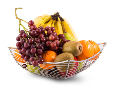 fruits in a basket: Composition with assorted fruits in metal basket isolated on white Stock Photo