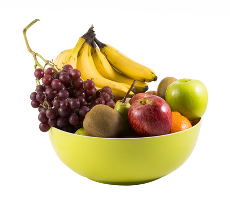 Composition with assorted fruits in big bowl isolated on white