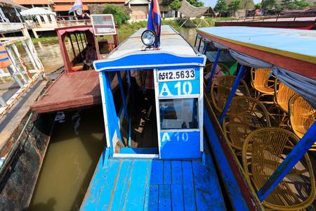 tonle sap: TONLE SAP LAKE SIEM REAP, CAMBODIA - JANUARY 10: Tourist boats park at harbor on January 10, 2012 at Tonle Sap Lake, Siem Reap Cambodia
