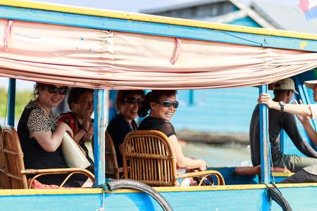 tonle sap: TONLE SAP LAKE SIEM REAP, CAMBODIA - JANUARY 10: unidentified tourists travel on Tourist boats on January 10, 2012 at Tonle Sap Lake, Siem Reap Cambodia