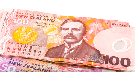 close up image of one hundred Dollar notes in New Zealand currency