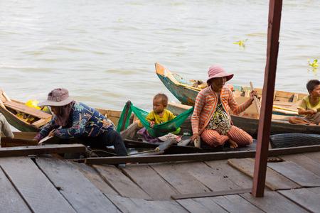 tonle sap: TONLE SAP LAKE SIEM REAP, CAMBODIA - JANUARY 10: Cambodian people live on Tonle Sap Lake on January 10, 2012 at Tonle Sap Lake, Siem Reap Cambodia.