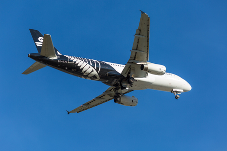 voted: Queenstown, New Zealand - September 1: Air New Zealand plane takes off in Queenstown International Airport on September 1, 2014 in Queenstown, New Zealand. Queenstown International Airport  has been voted the worlds most scenic airport approach