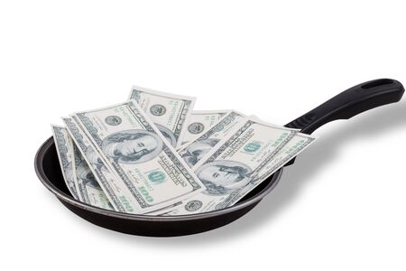 non stick: Dollar bills in used Non stick frying pan isolated on white
