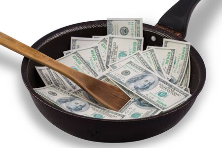 non stick: Money in used Non stick frying pan isolated on white Stock Photo