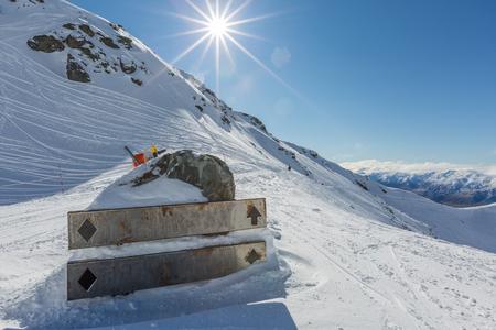 metalic: Metalic sign on the snow on the Mountain Stock Photo