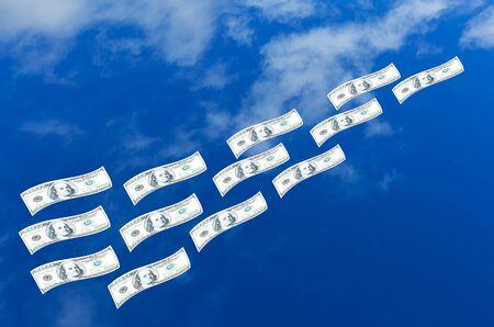 dinero volando: D�lares de dinero volando en el cielo azul