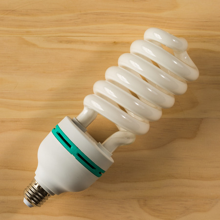 overhead shot: overhead shot of light bulb on wooden background
