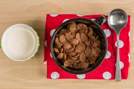 cornflakes: overhead shot image of Breakfast Chocolate Cornflakes Cereal with spoon and milk