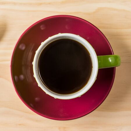 overhead shot: overhead shot image of coffee cup on wooden background