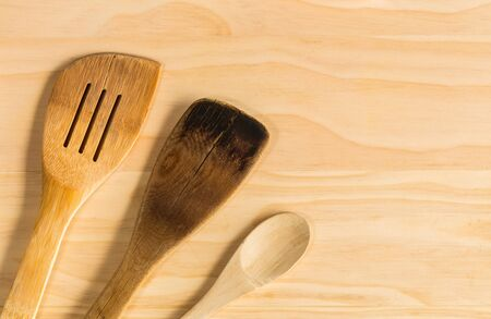 overhead shot: overhead shot image of Old wooden spoons and stirrers on wooden table