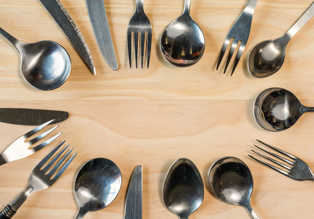overhead shot: overhead shot image of cutlery background on wooden table Stock Photo