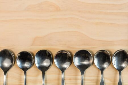 overhead shot: overhead shot image of spoons background on wooden background