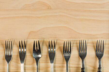 overhead shot: overhead shot image of forks background on wooden background