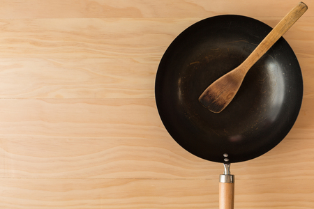 wok: asian style wok on wooden background Stock Photo