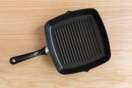 non stick: non stick grill pan on wooden background