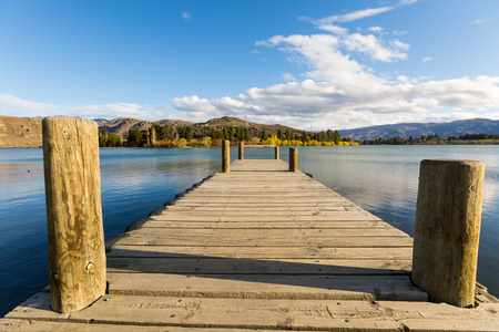 pier: wooden pier by the lake Stock Photo