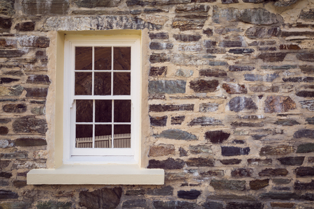 glass house: vintage style window and old stone wall Stock Photo